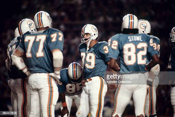 Runningback Larry Csonka of the Miami Dolphins in the huddle during a game against the St Louis Cardinals on November 27 1972 at the Orange Bowl in...