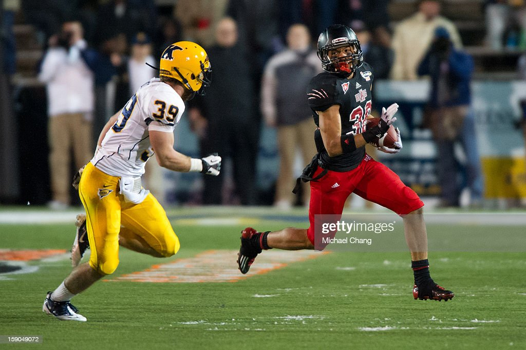 Runningback Rocky Hayes #38 of the Arkansas State Red Wolves looks to run past safety Luke Wollet #39 of the Kent State Golden Flashes on January 6, 2013 at Ladd-Peebles Stadium in Mobile, Alabama. At halftime Arkansas State leads Kent State 14-10.