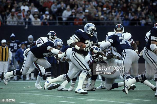 Runningback Ron Springs of the Dallas Cowboys runs with the ball during a game on October 30 1983 against the New York Giants at Giants Stadium in...