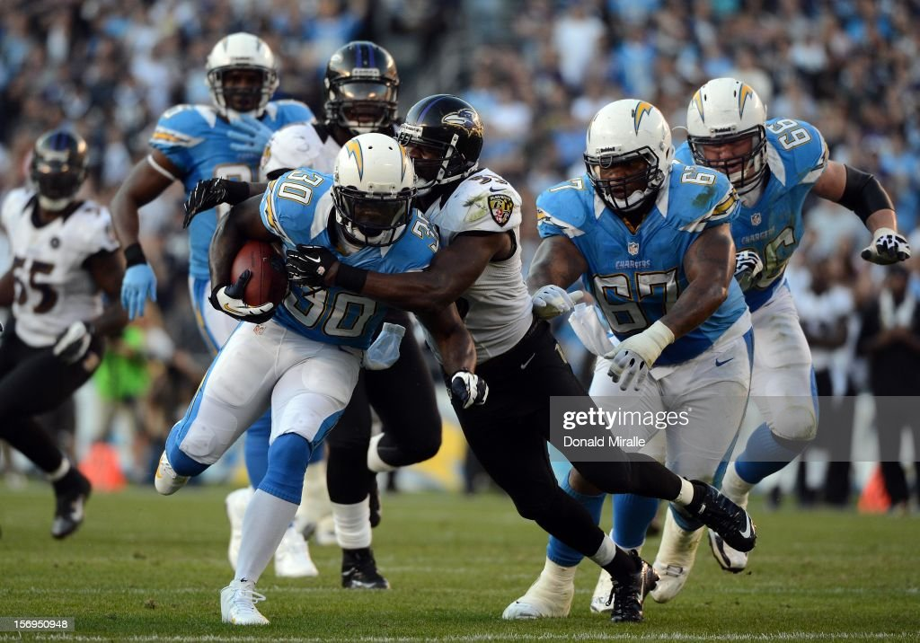 Runningback <a gi-track='captionPersonalityLinkClicked' href=/galleries/search?phrase=Ronnie+Brown&family=editorial&specificpeople=228574 ng-click='$event.stopPropagation()'>Ronnie Brown</a> #30 of the San Diego Chargers runs against the Baltimore Ravens during the Raven's for a 16-13 overtime win over the San Diego Chargers on November 25, 2012 at Qualcomm Stadium in San Diego, California.