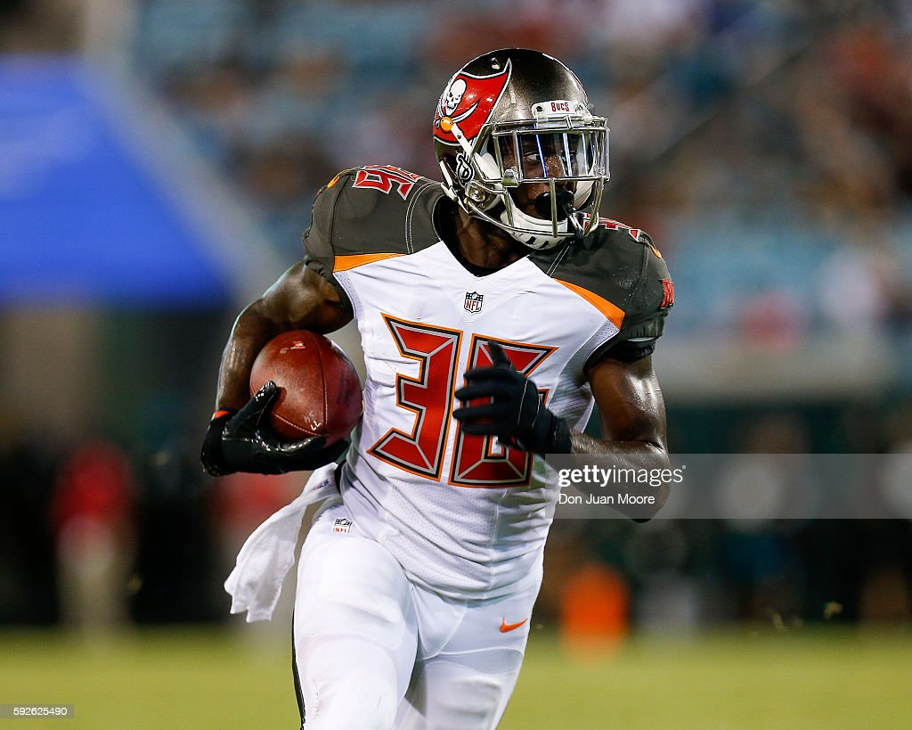Runningback Storm Johnson #36 of the Tampa Bay Buccaneers on a running play during a preseason game against the Jacksonville Jaguars at EverBank Field on August 20, 2016 in Jacksonville, Florida. The Bucs defeated the Jags 27 to 21.