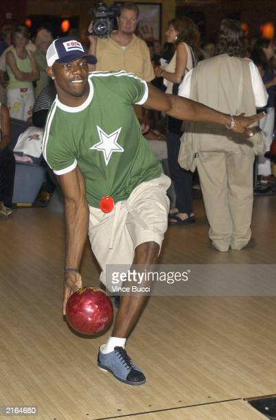 Runningback Terrell Owens bowls during the Gatorade ESPY Awards PreParty at the Lucky Strikes bowling alley on July 15 2003 in Hollywood California...