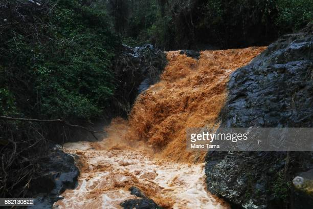 Runoff streams down a mountainside during heavy rains more than two weeks after Hurricane Maria hit the island on October 9 2017 in Jayuya Puerto...