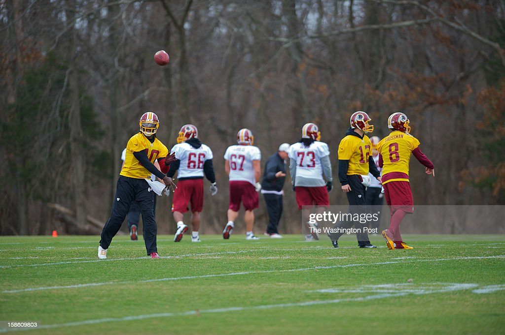 RGIII runs passing drills during the team's practice at Redskins Park in Ashburn, VA. RGIII suffered a knee injury during the game against the Baltimore Ravens. So far there have been no updates yet if he will play the Eagles on Sunday December 23rd.