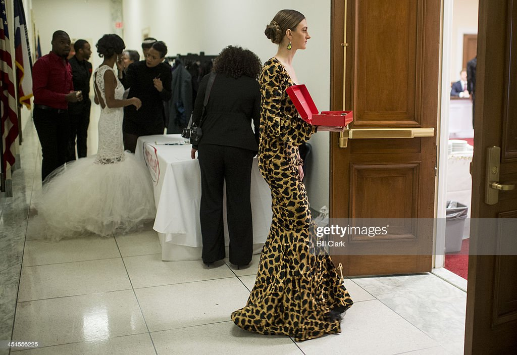 Runway models arrive to serve chocolate covered strawberries and sparkling cider to attendees of the Secular Coalition for America's release of its...