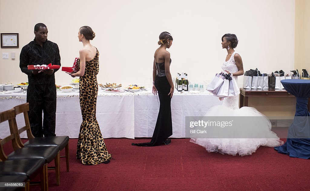Runway models prepare to serve chocolate covered strawberries and sparkling cider to attendees of the Secular Coalition for America's release of its...