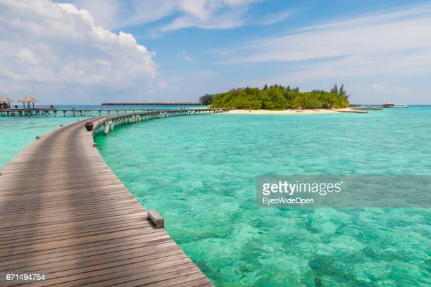 Runway to the white sandy Beach and turquois Water at Coco Bodu Hiti NorthMaleAtoll on February 26 2017 in Male Maldives