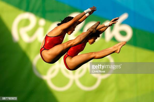 Ruolin Chen and Huixia Liu of China compete in the Women's Diving Synchronised 10m Platform Final on Day 4 of the Rio 2016 Olympic Games at Maria...