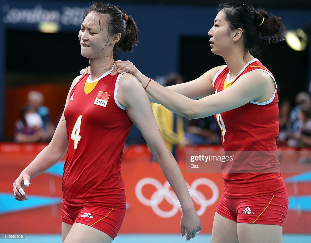 Ruoqi Hui #4 and Junjing Yang #9 of China react after losing to Japan in five sets during Women's Volleyball on Day 11 of the London 2012 Olympic Games at Earls Court on August 7, 2012 in London, England.