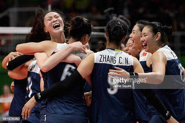 Ruoqi Hui of China celebrates victory over the Netherlands with her teammates in the Women's Volleyball Semifinal match at the Maracanazinho on Day...