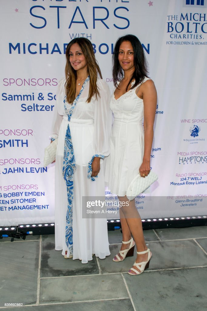 Rupa Mikkilineni and Radha Mikkilineni attend An Intimate Evening Under The Stars With Michael Bolton at Private Residence on August 19, 2017 in Bridgehampton, New York.