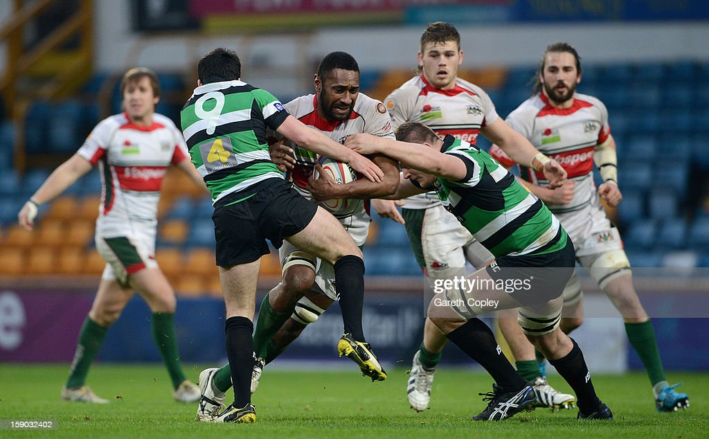 Rupeni Nasiga of Plymouth is tackled by James Doherty and Sam Lockwood of Leeds during the RFU Championship match between Leeds Carnegie and Plymouth Albion at Headingley Carnegie Stadium on January 6, 2013 in Leeds, England.