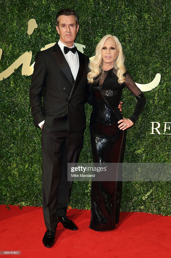 Rupert Everett and Donatella Versace attends the British Fashion Awards 2013 at London Coliseum on December 2, 2013 in London, England.