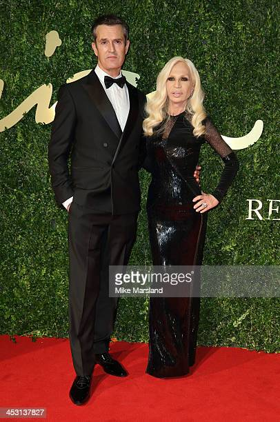 Rupert Everett and Donatella Versace attends the British Fashion Awards 2013 at London Coliseum on December 2 2013 in London England