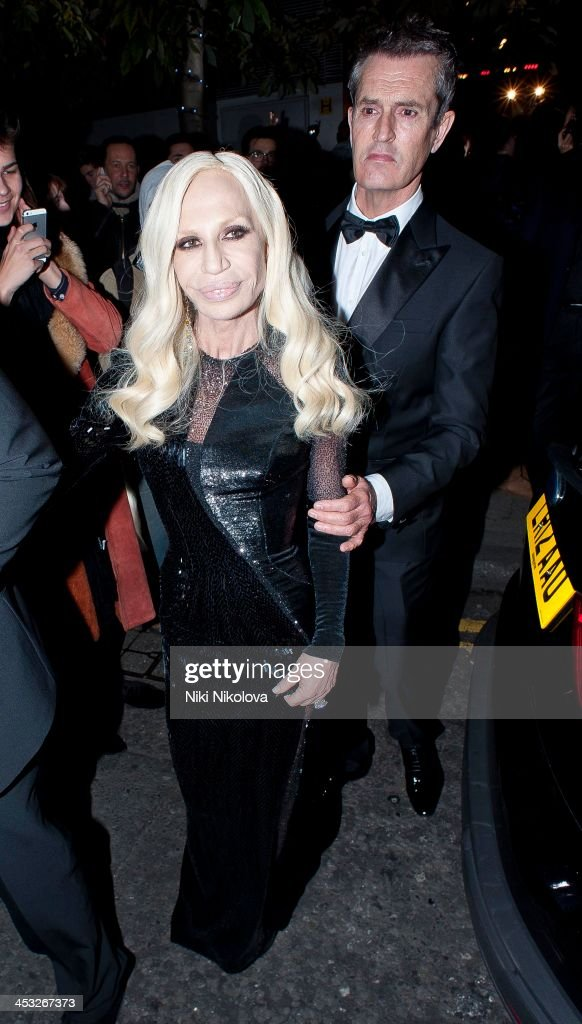 Rupert Everett and Donatella Versace is sighted leaving the British Fashion Awards 2013 on December 2, 2013 in London, England.