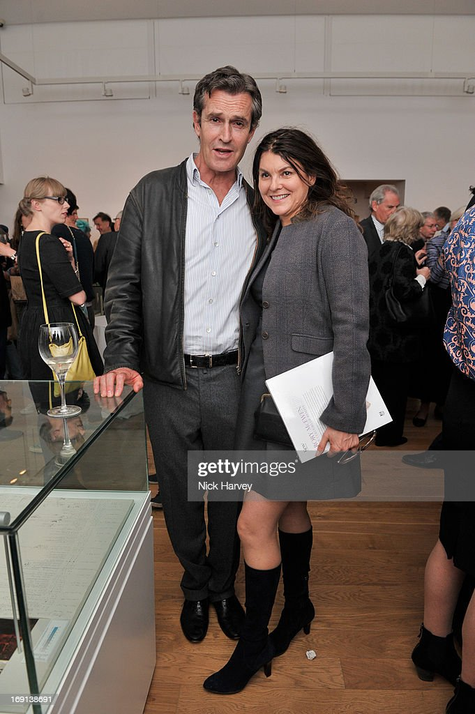 <a gi-track='captionPersonalityLinkClicked' href=/galleries/search?phrase=Rupert+Everett&family=editorial&specificpeople=206208 ng-click='$event.stopPropagation()'>Rupert Everett</a> and Geraldine Mary Harmsworth attend Rory McEwen - The Colours of Reality at Kew Gardens on May 20, 2013 in London, England.