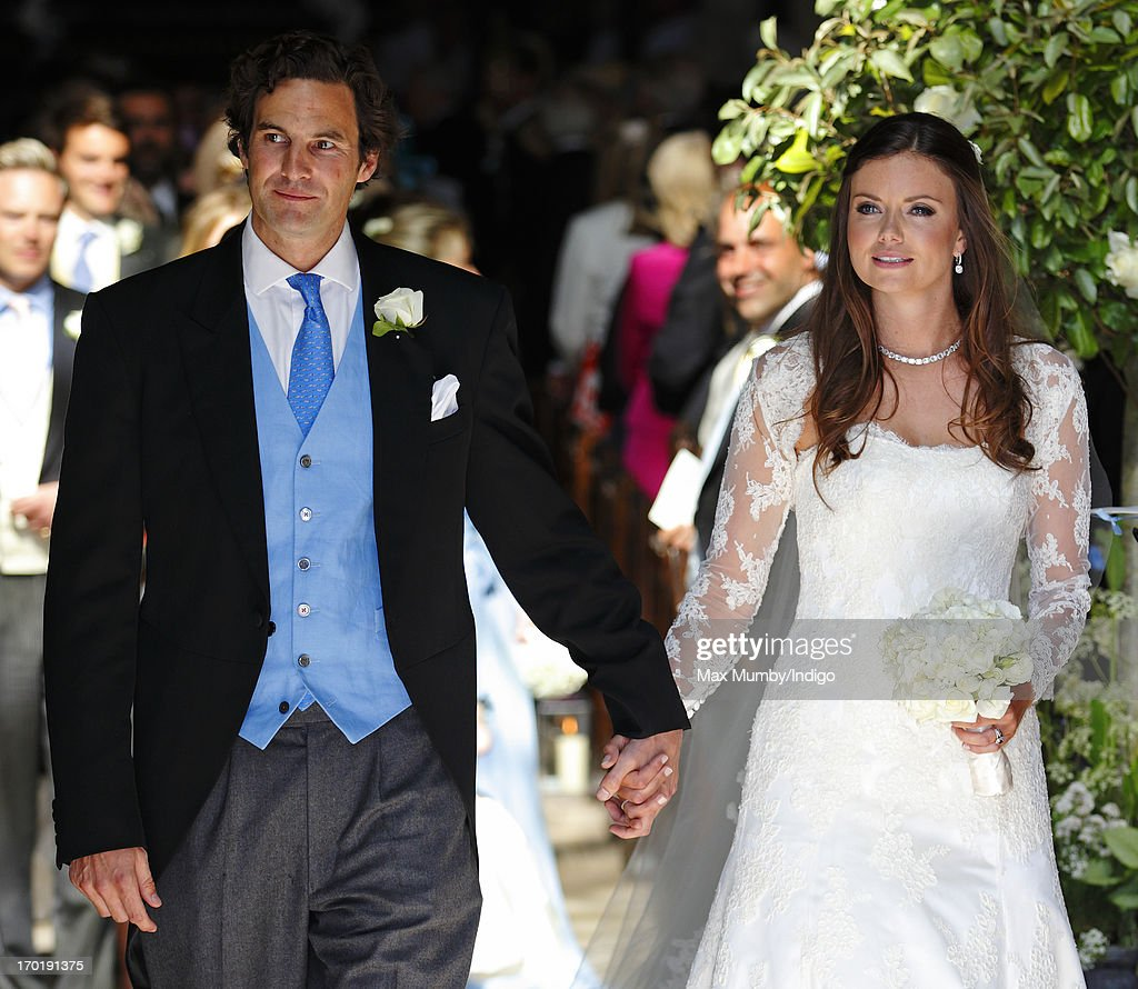 Rupert Finch and Lady Natasha Rufus Isaacs leave the church of St John the Baptist after their wedding on June 8, 2013 in Cirencester, England.