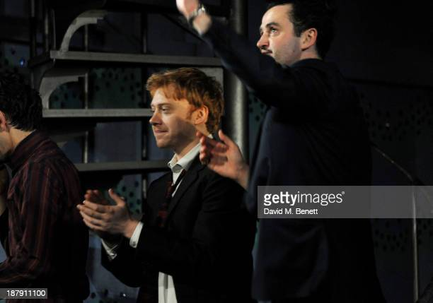 Rupert Grint and Daniel Mays bow at the curtain call during the press night performance of 'Mojo' at the Harold Pinter Theatre on November 13 2013 in...