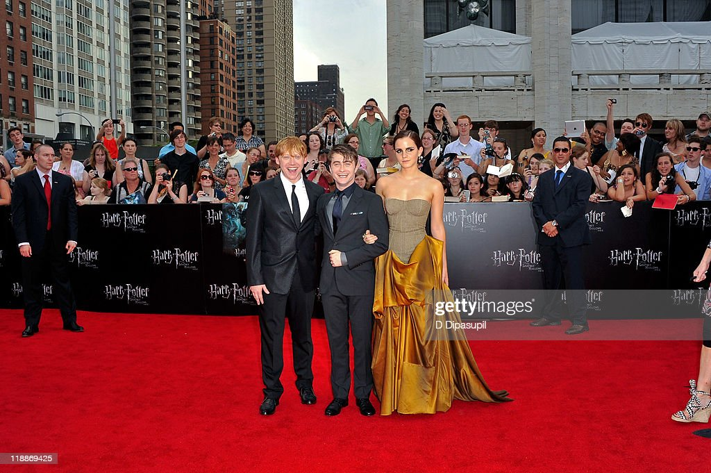 Rupert Grint, Daniel Radcliffe, and Emma Watson attend the premiere of 'Harry Potter and the Deathly Hallows: Part 2' at Avery Fisher Hall, Lincoln Center on July 11, 2011 in New York City.