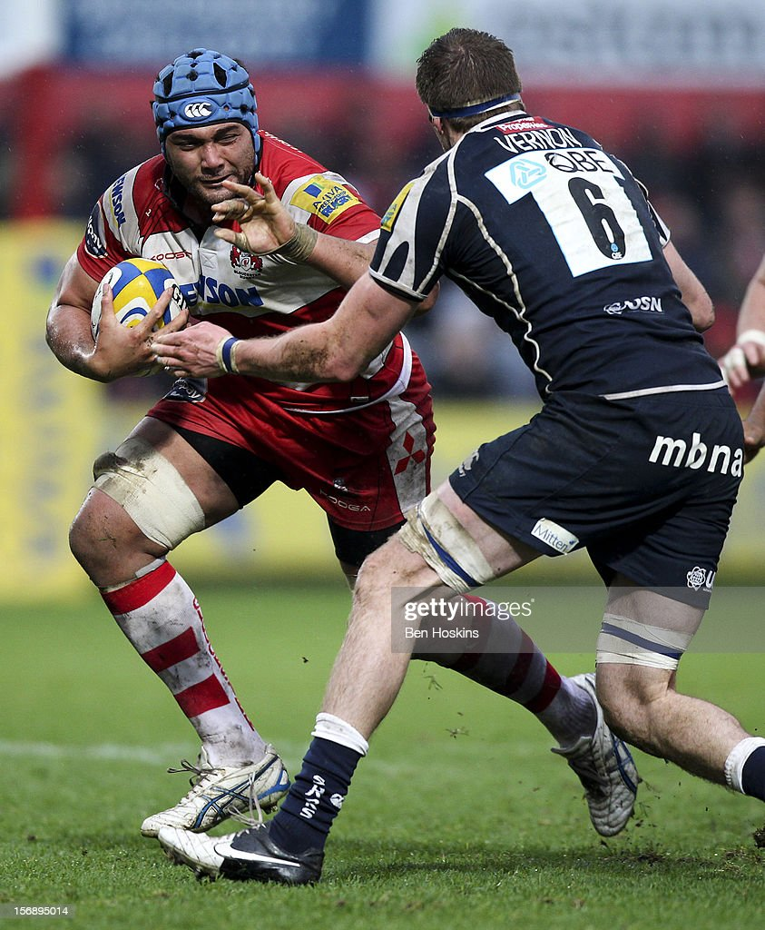 Rupert Harden of Gloucester runs at Richie Vernon of Sale during the Aviva Premiership match between Gloucester and Sale Sharks at the Kingsholm Stadium on November 24, 2012 in Gloucester, England.