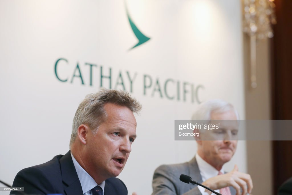 Rupert Hogg, chief executive officer of Cathay Pacific Airways Ltd., left, speaks as John Slosar, chairman, looks on during a news conference in Hong Kong, China, on Wednesday, Aug. 16, 2017. Cathay Pacific is slipping in its efforts to get passengers to pay more for its premium services in a test for new Chief Executive Officer Hogg as the company reported back-to-back losses. Photographer: Paul Yeung/Bloomberg via Getty Images