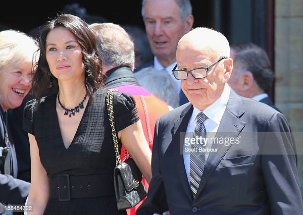 Rupert Murdoch and his wife Wendi Deng Murdoch leave after attending the Dame Elisabeth Murdoch public memorial at St Paul's Cathedral on December 18...