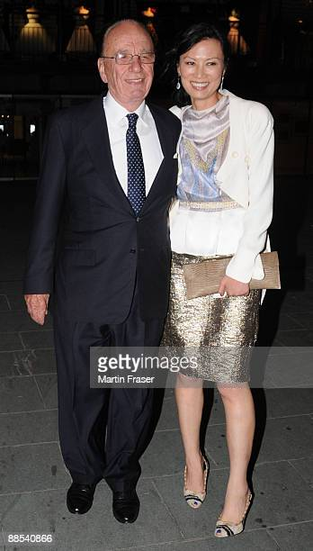 Rupert Murdoch and Wendi Deng leave Murdoch's annual summer party at the Oxo Tower on the South Bank of the River Thames on June 17 2009 in London...