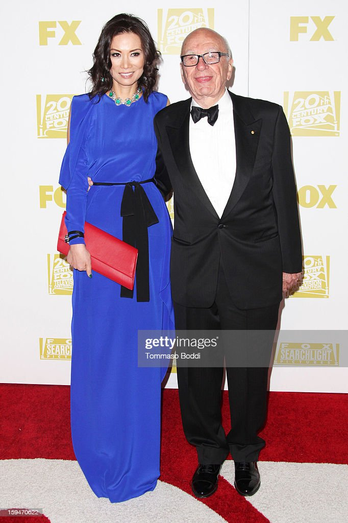 Rupert Murdoch (R) and guest attend the FOX Golden Globe after party held at the FOX Pavilion at the Golden Globes on January 13, 2013 in Beverly Hills, California.
