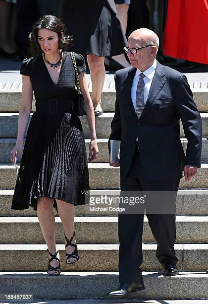 Rupert Murdoch and wife Wendi Deng leave the Dame Elisabeth Murdoch public memorial at St Paul's Cathedral on December 18 2012 in Melbourne Australia...