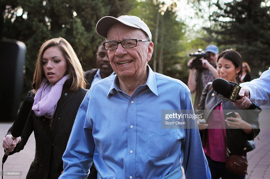 Rupert Murdoch, Chairman and CEO of News Corporation, is surrounded by media as he arrives at the Allen & Company Sun Valley Conference on July 7, 2011 in Sun Valley, Idaho. The conference has been hosted annually by the investment firm Allen & Company each July since 1983 and is typically attended by many of the world's most powerful media executives.