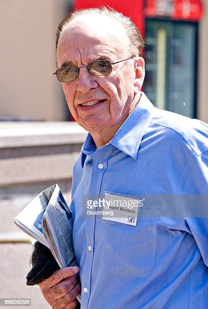 Rupert Murdoch chairman and chief executive officer of News Corp walks outside during the Allen Co Media and Technology Conference in Sun Valley...