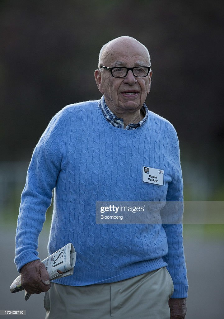 Rupert Murdoch, chairman and chief executive officer of News Corp., walks to a morning session at the Allen & Co. Media and Technology Conference in Sun Valley, Idaho, U.S., on Saturday, July 13, 2013. Executives from media, finance and politics mingle at the mountain resort between presentations on business trends and social issues, brought together by New York investment banker Herb Allen. Photographer: Scott Eells/Bloomberg via Getty Images
