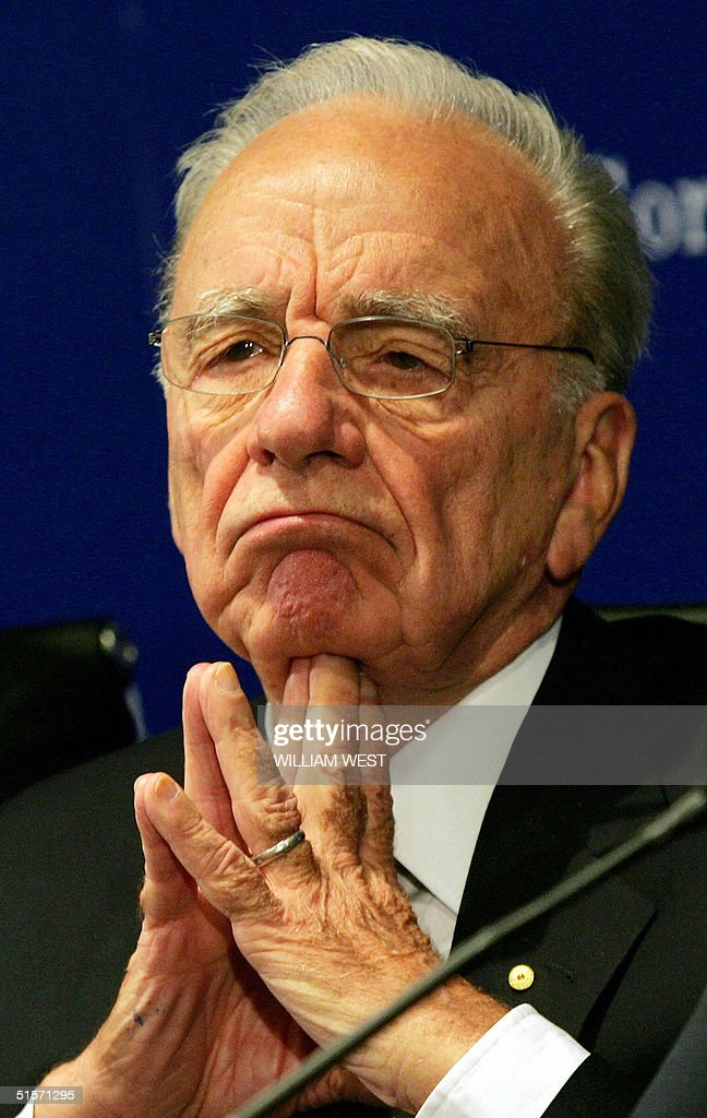 <a gi-track='captionPersonalityLinkClicked' href=/galleries/search?phrase=Rupert+Murdoch&family=editorial&specificpeople=160571 ng-click='$event.stopPropagation()'>Rupert Murdoch</a>, chairman of media heavyweight News Corp., listens to a question from the media after chairing the company's annual general meeting in Adelaide, 26 October 2004. News Corp shareholders are expected to vote in support of Murdoch's plans to move his media empire's headquarters to the United States. AFP PHOTO/William WEST