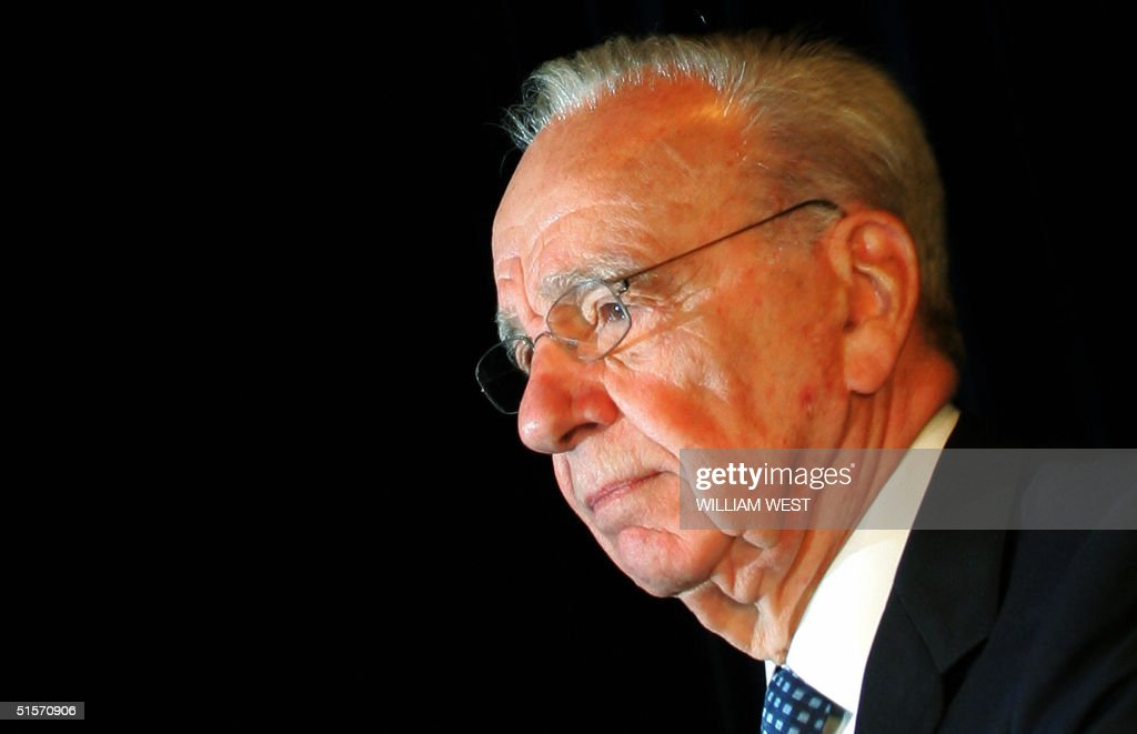 <a gi-track='captionPersonalityLinkClicked' href=/galleries/search?phrase=Rupert+Murdoch&family=editorial&specificpeople=160571 ng-click='$event.stopPropagation()'>Rupert Murdoch</a> (L), chairman of media heavy-weight News Corp. looks out over the shareholders at the start of the company's AGM being held in Adelaide 26 October 2004. News Corp shareholders are voting on Murdoch's plans to move his media empire's headquarters to the United States. AFP PHOTO/William WEST