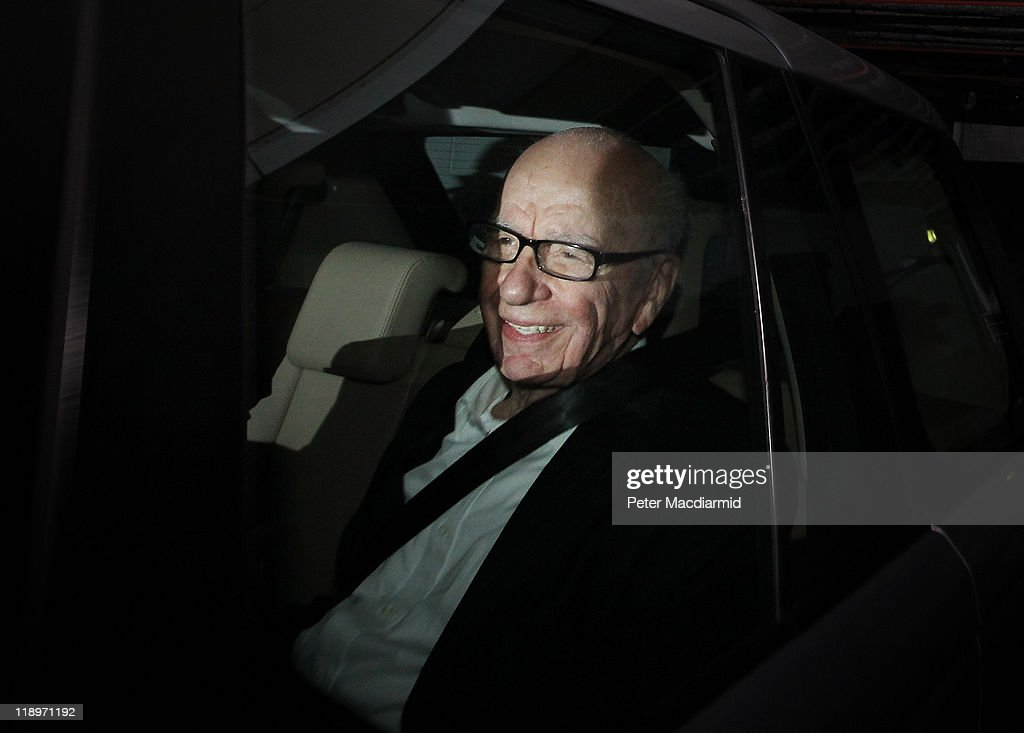 <a gi-track='captionPersonalityLinkClicked' href=/galleries/search?phrase=Rupert+Murdoch&family=editorial&specificpeople=160571 ng-click='$event.stopPropagation()'>Rupert Murdoch</a>, Chief Executive Officer of News Corp., smiles at photographers as he is driven from News International's headquarters on July 13, 2011 in London, England. News Corp. have announced that they are no longer bidding to by the remaining shares of BSkyB.