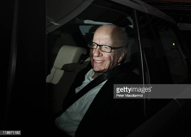 Rupert Murdoch Chief Executive Officer of News Corp smiles at photographers as he is driven from News International's headquarters on July 13 2011 in...