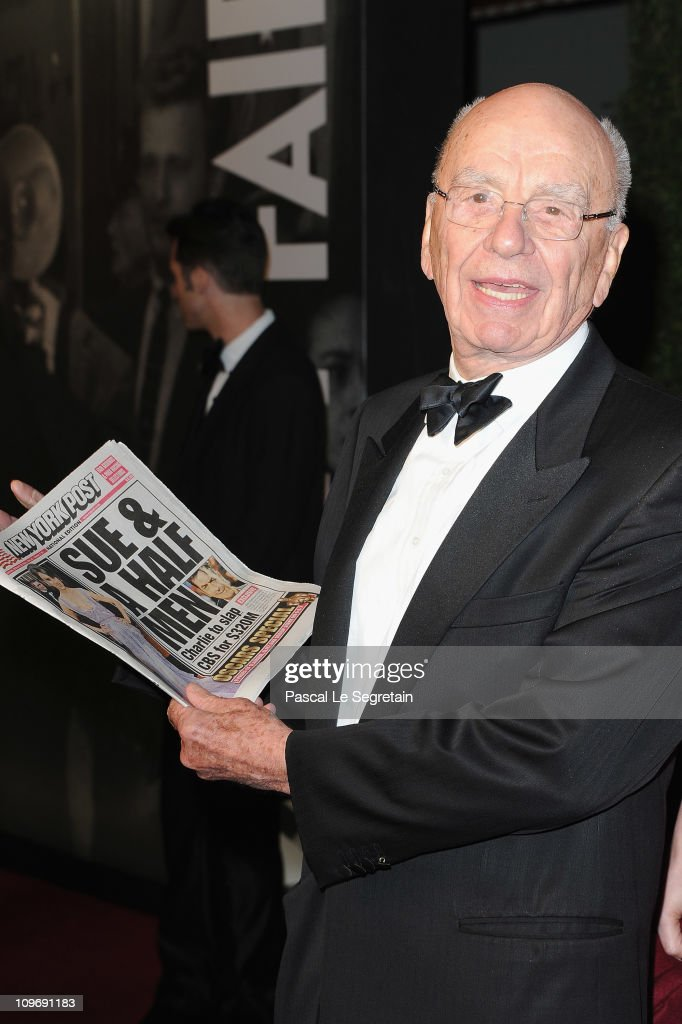 <a gi-track='captionPersonalityLinkClicked' href=/galleries/search?phrase=Rupert+Murdoch&family=editorial&specificpeople=160571 ng-click='$event.stopPropagation()'>Rupert Murdoch</a> holds a copy of the New York Post as he arrives to attend the Vanity Fair Oscar party hosted by Graydon Carter held at Sunset Tower on February 27, 2011 in West Hollywood, California.