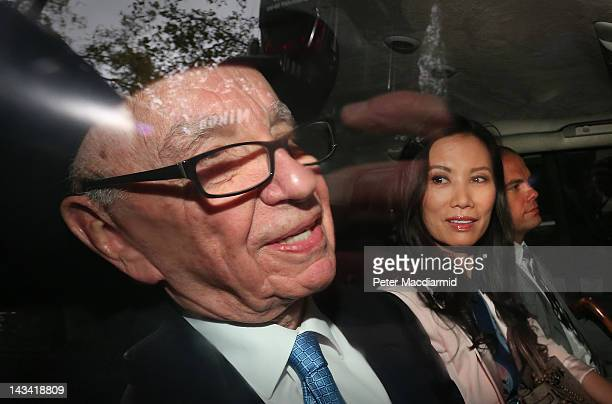 Rupert Murdoch is driven from The Royal Courts of Justice with his wife Wendi Deng Murdoch and son Lachlan after giving evidence to The Leveson...