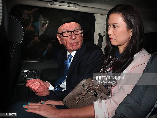Rupert Murdoch looks to his wife Wendi Deng Murdoch as they are driven from The Royal Courts of Justice after he gave evidence to The Leveson Inquiry...