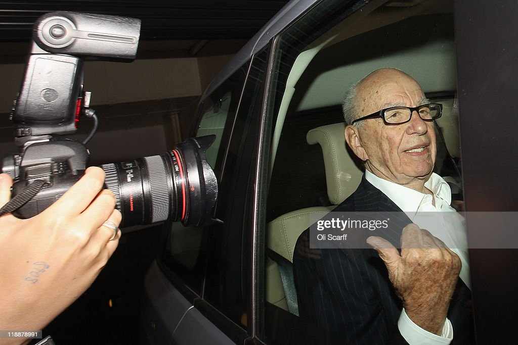 <a gi-track='captionPersonalityLinkClicked' href=/galleries/search?phrase=Rupert+Murdoch&family=editorial&specificpeople=160571 ng-click='$event.stopPropagation()'>Rupert Murdoch</a>, the chief executive officer of News Corp., is driven from his apartment on July 12, 2011 in London, England. Allegations emerged yesterday that private investigators working for The Sun and The Sunday Times newspapers, owned by Mr Murdoch's company, targeted former Prime Minister Gordon Brown to obtain bank details and his son's medical records.