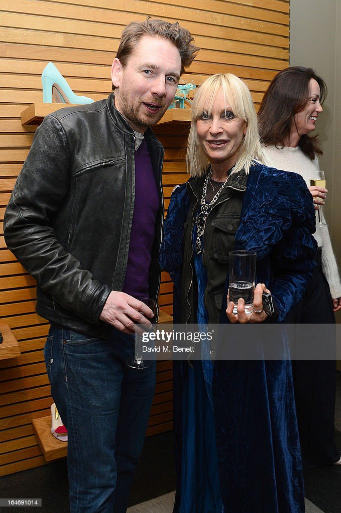 Rupert Sanderson and Virginia Bates attend a cocktail party for shoe designer Rupert Sanderson, hosted by Mariella Frostrup, at his Bruton Place store on March 26, 2013 in London, England.