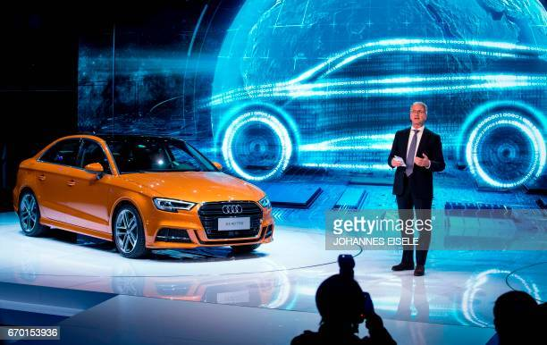 Rupert Stadler chairman of Audi AG speaks during the presentation of the new A3 40 TFSI car during the first day of the 17th Shanghai International...