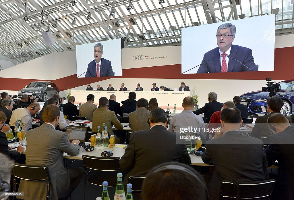 Rupert Stadler, chief executive officer of Audi AG, is seen on large video screen as he speaks during the company's earnings news conference at the Audi AG headquarters in Ingolstadt, Germany, on Tuesday, March 12, 2013. Audi AG, the world's second-biggest luxury carmaker, is aiming for a 'slight' increase in revenue this year and reaching an operating margin at the upper end of its long-term target corridor, helped by sales of compact SUVs and the new A3 sedan. Photographer: Guenter Schiffmann/Bloomberg via Getty Images