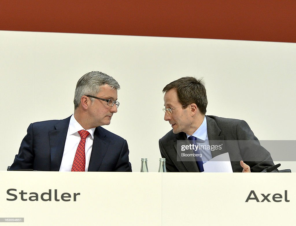 Rupert Stadler, chief executive officer of Audi AG, left, speaks with Axel Strotbek, chief financial officer of Audi AG, during the company's earnings news conference at the Audi AG headquarters in Ingolstadt, Germany, on Tuesday, March 12, 2013. Audi AG, the world's second-biggest luxury carmaker, is aiming for a 'slight' increase in revenue this year and reaching an operating margin at the upper end of its long-term target corridor, helped by sales of compact SUVs and the new A3 sedan. Photographer: Guenter Schiffmann/Bloomberg via Getty Images