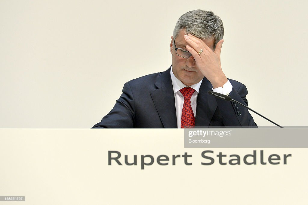 <a gi-track='captionPersonalityLinkClicked' href=/galleries/search?phrase=Rupert+Stadler&family=editorial&specificpeople=870122 ng-click='$event.stopPropagation()'>Rupert Stadler</a>, chief executive officer of Audi AG, reacts during the company's earnings news conference at the Audi AG headquarters in Ingolstadt, Germany, on Tuesday, March 12, 2013. Audi AG, the world's second-biggest luxury carmaker, is aiming for a 'slight' increase in revenue this year and reaching an operating margin at the upper end of its long-term target corridor, helped by sales of compact SUVs and the new A3 sedan. Photographer: Guenter Schiffmann/Bloomberg via Getty Images
