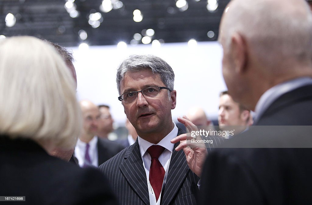 <a gi-track='captionPersonalityLinkClicked' href=/galleries/search?phrase=Rupert+Stadler&family=editorial&specificpeople=870122 ng-click='$event.stopPropagation()'>Rupert Stadler</a>, chief executive officer of Audi AG, speaks with delegates at the Volkswagen AG annual general meeting (AGM) in Hanover, Germany, on Thursday, April 25, 2013. Volkswagen AG, Europe's biggest automaker, aims to offset plunging European demand this year by rolling out 60 new and updated models, including luxury cruisers like the Bentley Flying Spur. Photographer: Chris Ratcliffe/Bloomberg via Getty Images