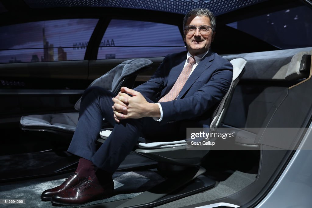 Rupert Stadler, head of German automaker Audi, poses for a photo in an Aicon Audi electric car at the Volkswagen Preview Night prior to the 2017 Frankfurt Auto Show on September 11, 2017 in Frankfurt am Main, Germany. The Frankfurt Auto Show is taking place during a turbulent period for the auto industry. Leading companies, including Volkswagen, have been rocked by the self-inflicted diesel emissions scandal. At the same time the industry is on the verge of a new era as automakers commit themselves more and more to a future that will one day be dominated by electric cars.