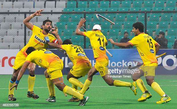 Rupinder Pal of India celebrates with team after score winning goal against Germay during the Hero Hockey World League Final Ranking match at...