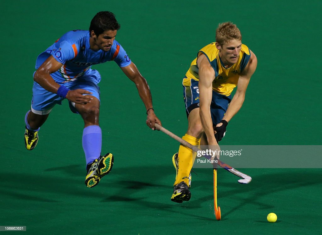 Rupinder Pal Singh of India and Craig Boyne of the Kookaburras contest for the ball in the mens Australia Kookaburras v India game during day two of the 2012 International Super Series at Perth Hockey Stadium on November 23, 2012 in Perth, Australia.