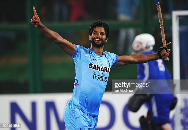 Rupinder Pal Singh of India celebrates after he scores to win the penalty shoot out for third place during the match between Netherlands and India on...